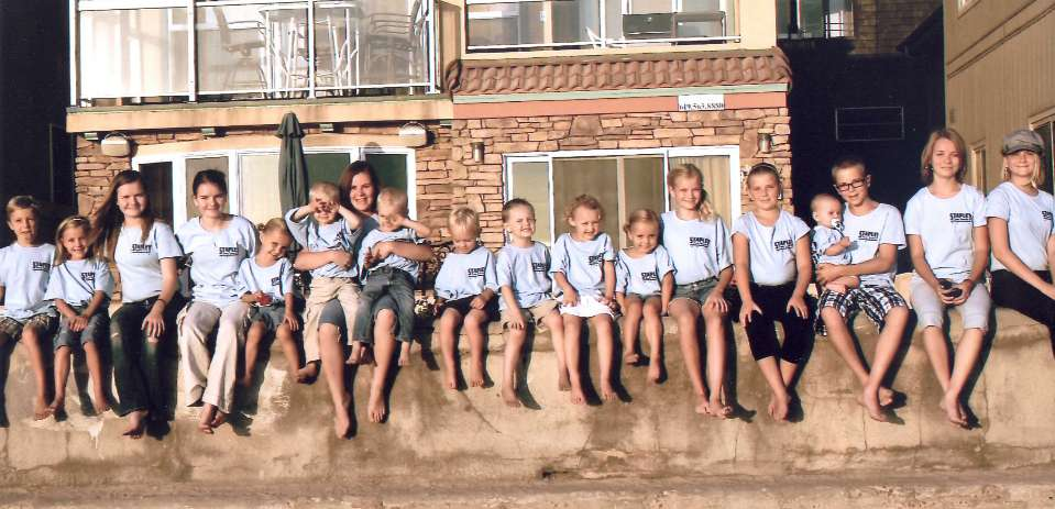 Thyrle And Roberta Stapley, Of The Gilbert 9th Ward, Have 21 Grandchildren (19 Shown Here). Eight Of The 21 Are Twins, One Set Born To Each Of The Stapley's Four Sons. Photo Courtesy Of Thyrle Stapley.
