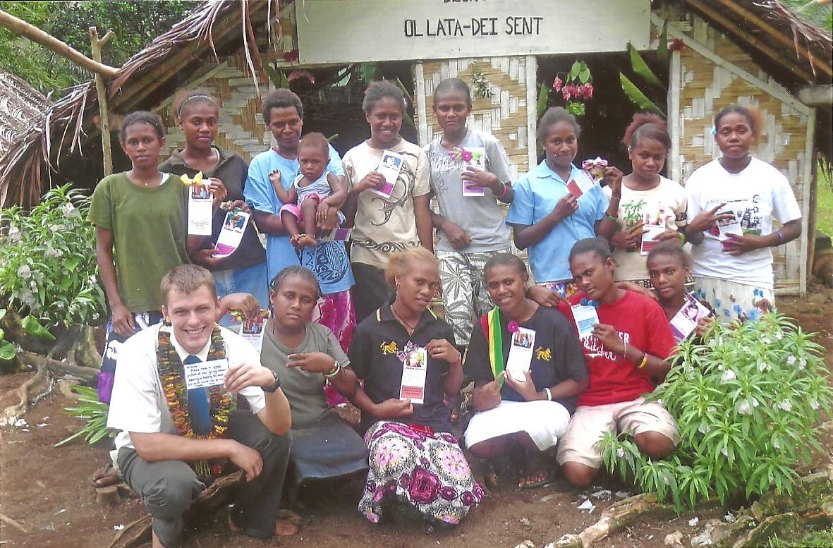 In Front Of Their Meetinghouse, Elder William Arnett (on Left) Poses With Young Women From The Remote Island Of Ambae, Vanuatu, Who Are Holding Hair Clips And Scripture Notes Made For Them By A Young Women's Group From Pinetop, Ariz. Photo Courtesy Elder William Arnett.