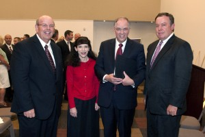 Participating in the groundbreaking ceremony for the new LDS Institute building on the ASU Polytechnic campus in East Mesa are (l to r) Elder Jim L. Wright of the Seventy, Sister Kathy Andersen, wife of Neil L. Andersen, of the Quorum of the Twelve Apostles of the Church of Jesus Christ of Latter-day Saints and Dr. Michael Crow, president of Arizona State University.  Photo by John Power Biltmore Photo