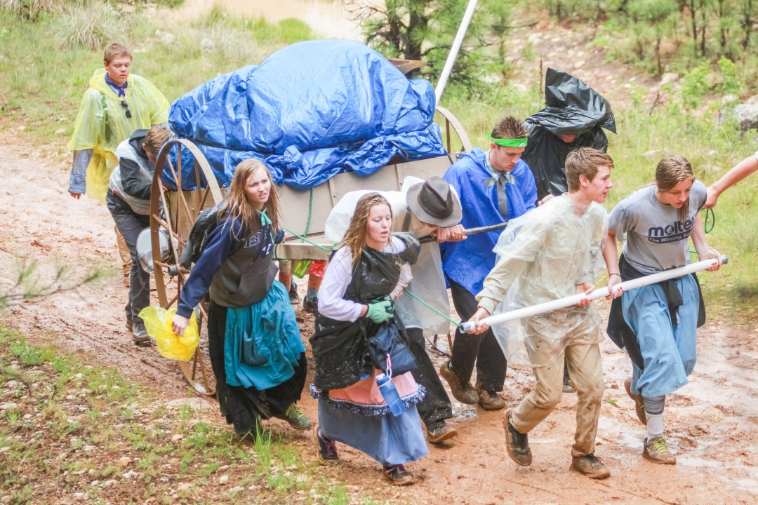 While rain added to the difficulties associated with the Queen Creek West Stake's pioneer trek, the Young Men and Young Women found strength and unity as they worked together in their assigned