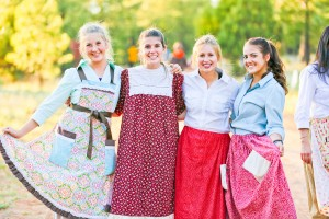 Young Women from the Hawes Ward (l-r) Paris Evans, Tatum Dawson, Mariah Dickerson and Jordyn Spencer, show off the pioneer dress they wore as part of the overall pioneer experience as they participated in the Queen Creek West Stake's trek this summer.