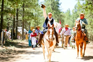 As the trek trail boss, Curtis Dickerson, of the Remington Heights Ward and stake patriarch of the Queen Creek West Stake, waves his hat as he leads out at the beginning of this summer's pioneer trek.