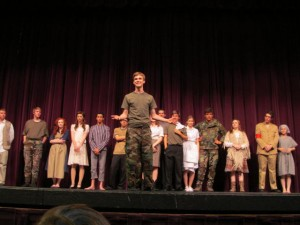 "Surrounded by members of his high school drama club, Kyle Ellingson (front) takes center stage after the performance of the play Kyle wrote, called ""The Hate Hypothesis: Love's Amazing Power."""