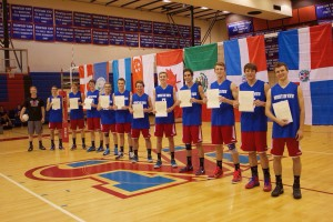 They supported each other on the court and off, as each of the 11 members of the year's varsity volleyball team from Mesa's Mountain View High School also shared the goal of serving a mission. They are shown holding their mission call letters and with flags from the various countries where they will serve.