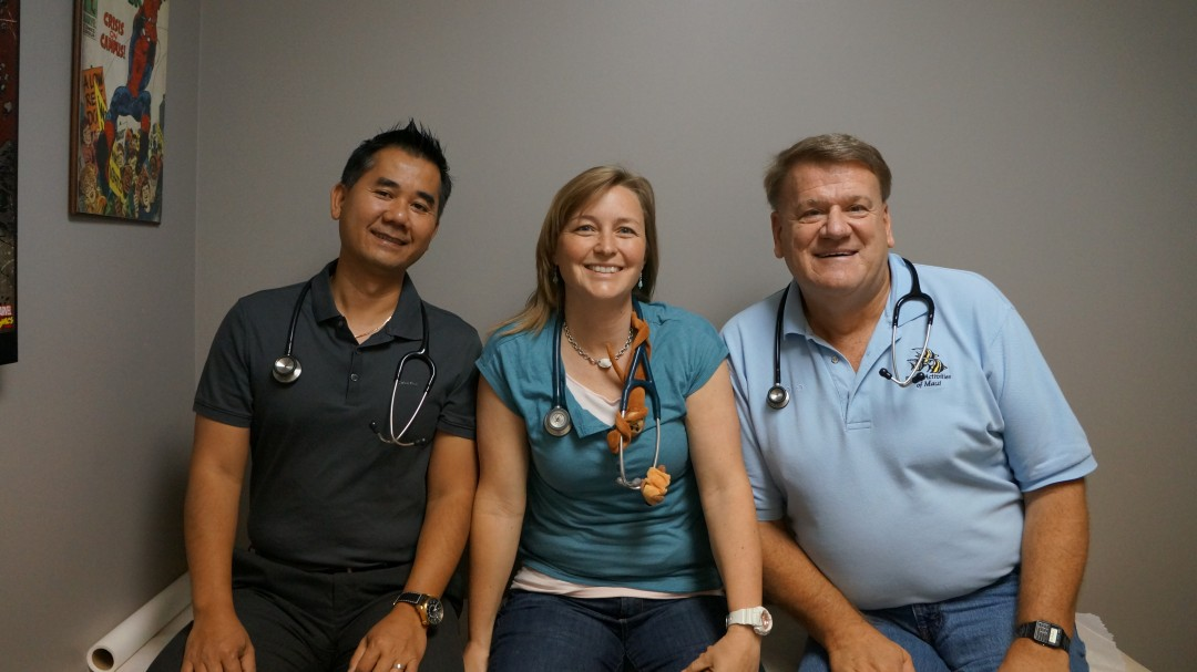Dr. Brittany Snow (center) with the other two providers at Canyon Pediatrics, Dr. Nguyen (l) and Dr. Kosiorek.
