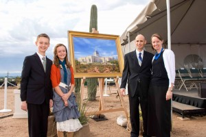 Following the groundbreaking ceremony for the Tucson Arizona Temple, families, such as Michael and Jenny Haymore and their children, Caleb and Hannah, of the La Canada Ward in the Tucson North Stake, were invited to turn over a shovelful of dirt and to take pictures in front of the rendition of what the finished temple will look like. Photo by John Power, Biltmore Photo.