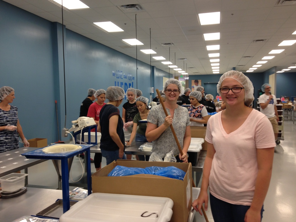 Young Women Volunteer At Feed My Starving Children In Mesa