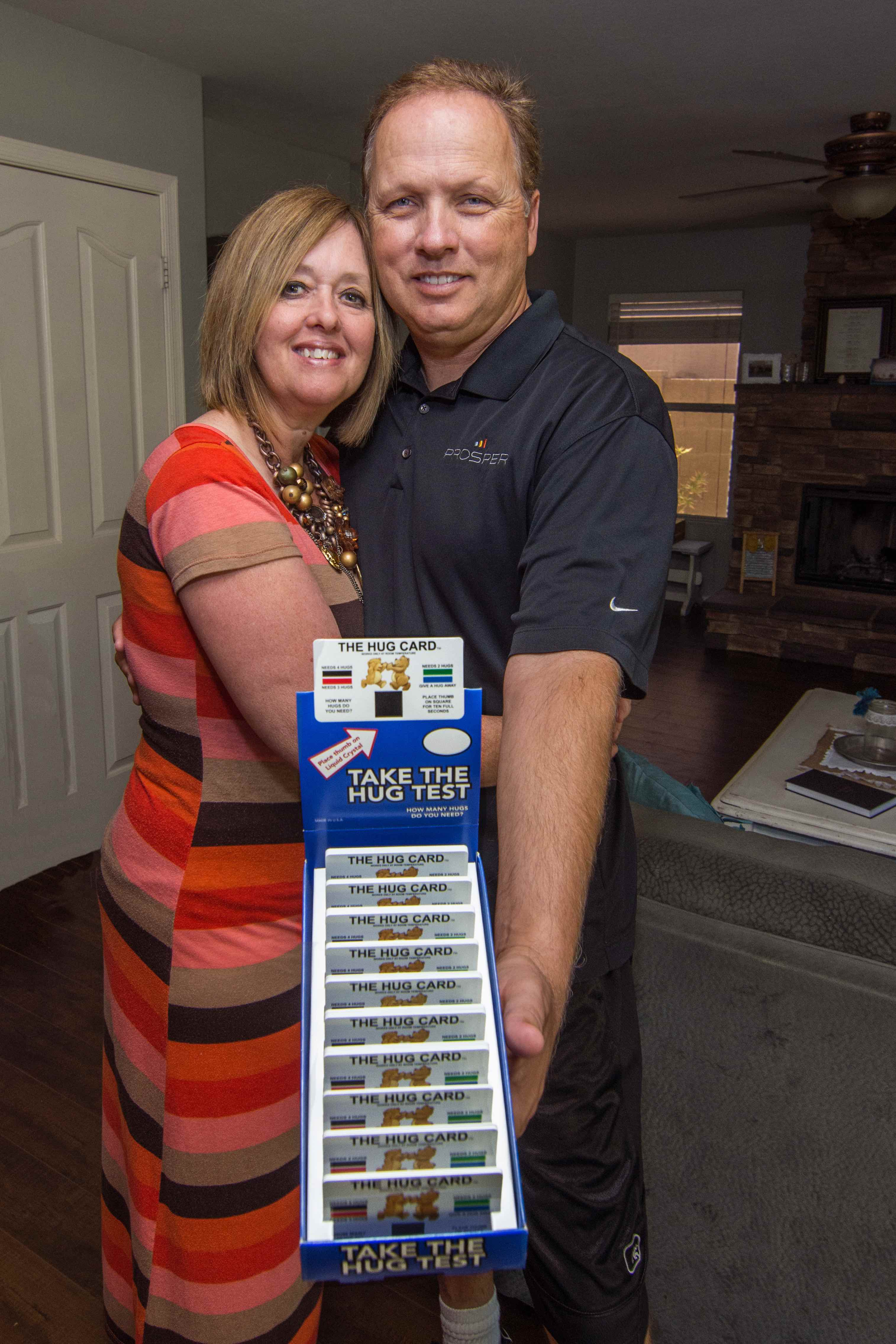 Phelecia And Brent Hatch, Of Gilbert, Say The Hug Card, By Giving People Permission To Hug, Can Stem Bullying, Repair Family Relationships And Can Open The Avenues Of Communication And Connection. Photo By John Power