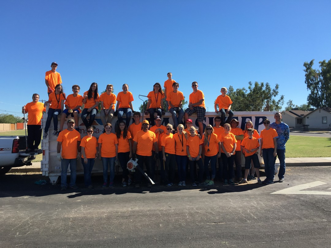 Youth and leaders from the Val Vista Ward, Mesa Mountain View Stake, filled five dumpsters in a few hours cleaning up an alley in their neighborhood as part of Make A Difference Day. Photo by Celia Hallsted