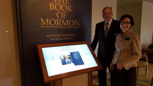 "After a closure of several weeks, the director of the Mesa Temple Visitors' Center, Elder Scott Cameron, along with his wife, Sister Christine Cameron, are excited to learn more and to become familiar with the new, interactive displays that are now open and are designed, among other things, to introduce people to the Book of Mormon, to give them a sense of what it is like to be ""a Mormon"" and to help them understand more about missionary work. Photo by Cecily Markland"