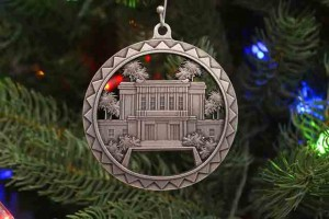Acorn Jewelry's Mesa Temple ornament, crafted of solid cast pewter, features the locale's iconic palm trees and reflection pool.