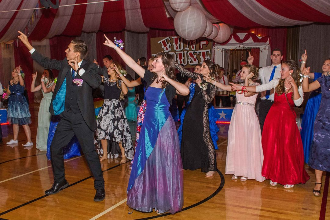 Youth from Buckeye, West Maricopa and Goodyear Stakes, along with dates from all over the Valley, bust their moves on the dance floor at the tri-stake prom. Photo by John Power, Biltmore Photo.