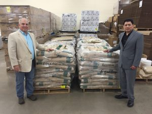 At the Bishops' Storehouse in Mesa, Ken Patricio Smith (l) and Dr. Patricio Herrera-Betancourt, the Consul General of Ecuador, at the Mesa Bishops' Storehouse, watch as supplies from Salt Lake are transferred onto a truck to take them to Los Angeles and from there to be shipped to help earthquake victims in Ecuador. Photo courtesy Ken Patricio Smith