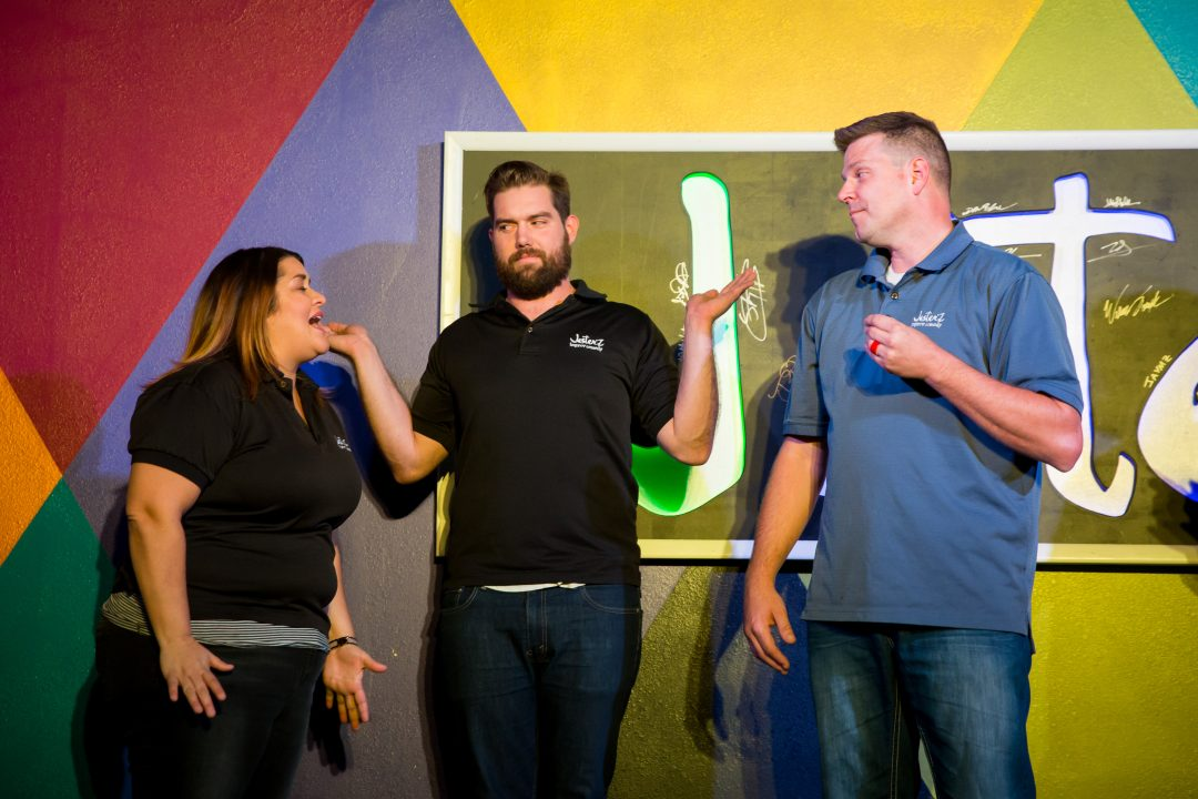 Mary Upchurch, Ryan Quenneville and Travis Johnson goof around onstage at the family-friendly venue at Jester'Z Improv Comedy. Photo courtesy of Leavitt Wells of Leave it to Leavitt Photography.