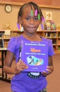 Mesa's 12 Books Program helps supply economically disadvantaged children with books. Photo courtesy of Mesa United Way.