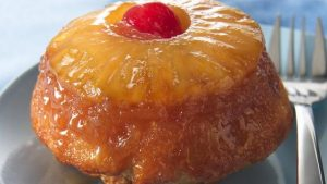 Cleaned-out tuna cans make for perfect single-serving pineapple upside-down cake treats. Recipe and photo by Simple As Pi