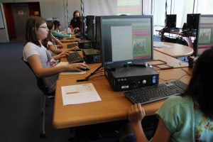 Coderistas hard at work in the Phoenix Public Library system. Photo courtesy of Lee Franklin