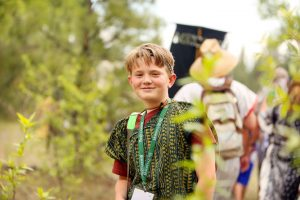 """Setting out to hike toward the """"Promised Land,"""" Blue Shepherd, a Deacon from the Cloud Creek Ward, Queen Creek Stake, joined the nearly 800 other Young Men and Young Women who witnessed four days of inspirational reenactments of Book of Mormon stories this summer. Photo by Chea Lamb"""