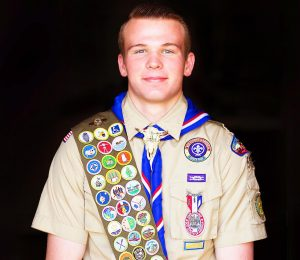 Clark Larsen, of the Hermosa Vista Stake in Mesa, amassed a total of 55 merit badges to earn his Eagle Scout Award followed by seven Eagle palms. Photo by Lyric Thruston