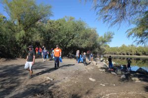 Volunteers from one of the nine groups collecting trash in their area along the Salt River in Tonto National Forest. Photo Courtesy of Patrick Ryan