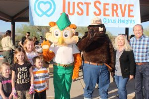 Patrick and Julia Ryan pictured with the Williams children of the Valley View Ward, along with Smokey the Bear and Woodsy Owl. Photo Courtesy of Patrick Ryan