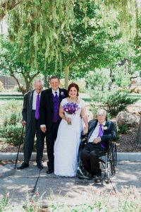 The happy couple with their grandfathers: (from left) Thomas Flenniken (age 102); groom, David Barker; bride, Christina Henrie; and Don Zundel (age 101.) Photo by Genevieve Hansen Photography