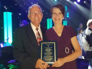 "For their ""lifetime of dedication to country music,"" Dean and Sheila Dutton were recently honored with a Lifetime Achievement Award at the Branson Terry Awards this past October. Photo by Don Farquhar."