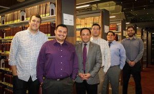 Sandra Day O'Connor College of Law student volunteers at the law library. Left to right: Brian H. Richardson, Salvador Macias, David Garcia, Daniel P. Chrisney, Jose A. Oliveros and John Van Dyk. Photo by Robin Finlinson