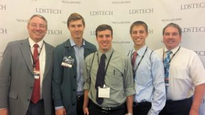 "The My Mission development team, including (l to r) David Wade, Sean Wade, Michael Ellsworth, Jared Curtis and Kevin Wade, after winning several awards, including the ""People's Choice"" award, in LDS Church's first worldwide ""Gospel App & Game Development Contest"" at the LDSTech Conference in Salt Lake City.  Photo courtesy of Kevin Wade."