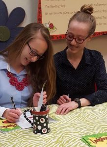 Twin sisters Anabella (l) and Sofia Schofield (r) sign copies of Ladybug's Garden, recently published by Pink Umbrella Books. Photo by Todd Schofield.