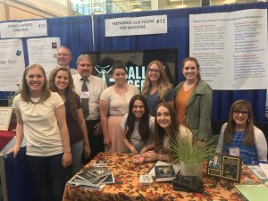At the BYU Women's Conference in Provo (from left to right) are Hailee Platt, Jane Tibbitts, David Wade, Kevin Wade, Callie Freshour, McKenna Milne and Jamie Armstrong. Front row seated are Ashtyn Heninger, Lexee Evans and Lynette Schloer. Photo courtesy of Kevin Wade.