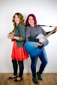 "Musicians Cherie Call (left) and Lyndy Butler (right) have won a prestigious John Lennon Songwriting Contest award for their children's song, ""The Astronaut and the Mermaid,"" from their album The Buddy System. Photo courtesy of R Legacy Distribution."