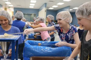 Time to Blossom participants were also able to serve at Mesa's Feed My Starving Children. Photo courtesy of Time to Blossom.