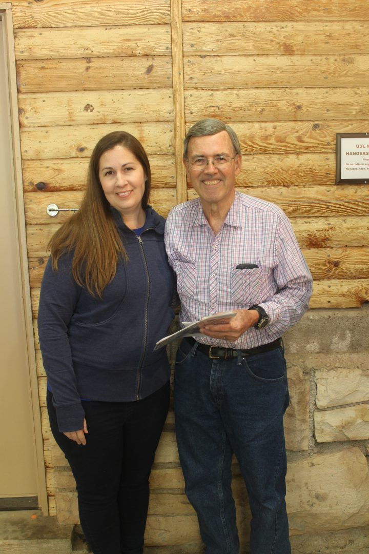 Lindsay Hicks Watrous (right), who was rescued by Joe Wise in 1991, was among those who honored Wise for his 26 years of service at Camp LoMia. Photo by: Kaylee Petrie