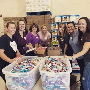 Volunteers at AZBrainfood spend about an hour on Thursdays filling weekend food bags for local school children in 6 school districts. Photo courtesy of Alison Schmid
