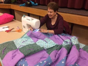 Carma King putting the finishing touches on a quilt. Photo courtesy of Jill Adair.