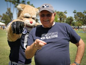 BYU mascot Cosmo poses with a former Cosmo, Ken Driggs. Photo by Robin Finlinson.