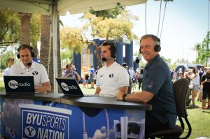 Mesa Mayor John Giles with announcers Spencer Linton (left) and Jarom Jordan (middle), just before he becomes part of the live broadcast of BYU Sports Nation from Pioneer Park. Photo by Robin Finlinson.