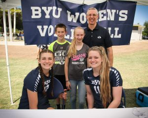 The Finlinson family poses with volleyball players Roni Jones-Perry (left) and Lacy Haddock. Photo by Robin Finlinson.