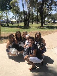 BYU Cheerleaders with some young fans at Fan Fest.