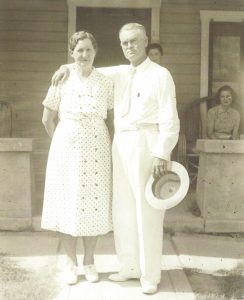 James Warren LeSueur, son of Arizona pioneer, John Taylor, and his wife, Anna Anderson LeSueur, are pictured in front of their Mesa home, which still stands at 2nd Avenue and Hibbert. In the background, on the right, is their daughter, Margaret Steverson, who still lives in Mesa.