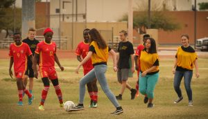 Youth from the Chandler East Stake play soccer with a team of refugees from five Central African countries. LDS youth from left to right: Trevin Dawe, unidentified girl, Reilly Harris, Lily Ackerman and Lexi Frias. Photo by Robin Finlinson