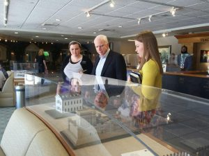 Sister Missionaries explain Vistors' Center displays to Senator McCain. Photo courtesy of The Sanchez Family.