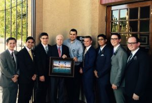 Local Missionaries, Brother Sanchez present John McCain with a picture of The Mesa Arizona Temple. Photo courtesy of The Sanchez Family.