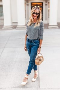 Charlotte Alvey models Espadrille wedges, a basket bag, and red lips--common accessories found on Parisian streets. Photo by Anne Healey.
