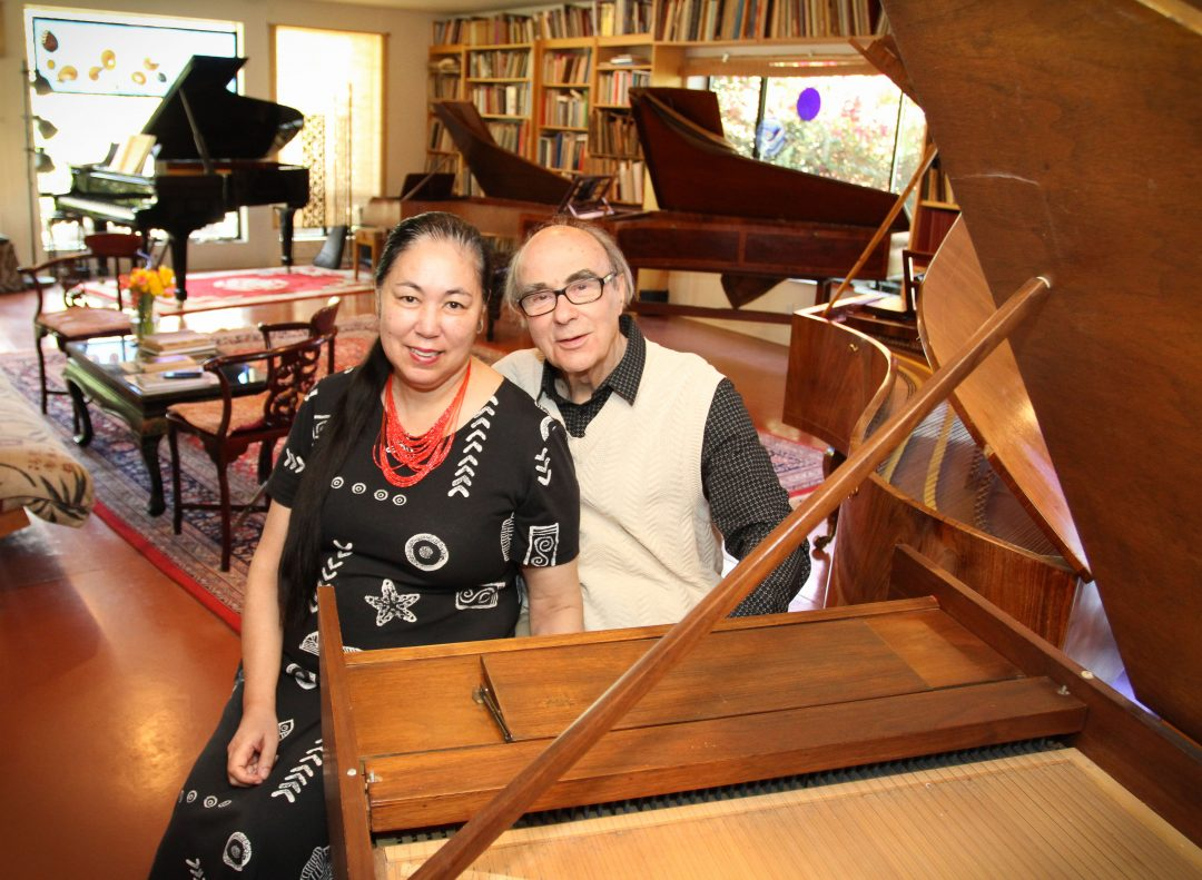 The Sellheims, sitting at their American-made harpsichord. Other instruments are labeled from left to right. 1990 Steinway and three fortepianos: Mozart-era (mid-1700s) replica; 1798 Broadwood & Son original; and 1835 Joseph Schrimpf original. Photo by Robin Finlinson.