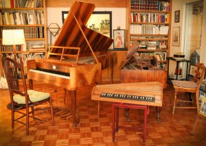 "Left to right: Six-pedaled 1810 fortepiano replica; spinettino replica of the early 1500s (on stand); and original 1836 ""Jane Austen"" square piano by Broadwood & Son. Photo by Robin Finlinson."
