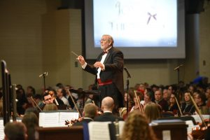 Conductor Dr. Mike Wilson will again conduct Voices of Christmas, a free concert featuring a choir and orchestra along with video presentations.  Photo by Darren Ewring