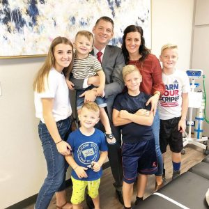 Dr. Ryan Jones, pictured with his wife, Taya, and five children, opened Vein Envy after a 13-year career in the United States Air Force. Photo by Kirstynn Evans