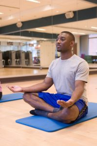 Yoga and meditation are two of many ways your workplace can get fit—physically and mentally—this new year. Photo by CDC/ Amanda Mills acquired from Public Health Image Library